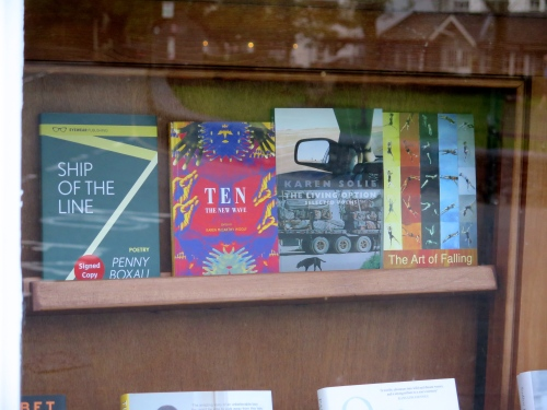 Some of our readers' books in the window of Sam Read's Bookshop, Grasmere.